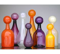 Gorgeous color in these blown-glass bottles. Kind of like big 'Sorry' game pieces.