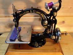 I Love old sewing machines..... God please cure me of this addiction *LOL*