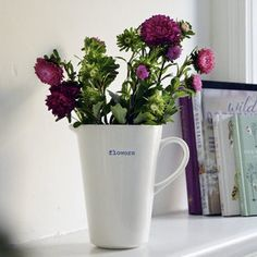 Ceramic Flower Jug by Keith Brymer Jones. Beautiful white ceramic vases, perfect for displaying hand-picked flowers from the garden. An easy way to dress up the classic flowers and a card this Mother's Day.