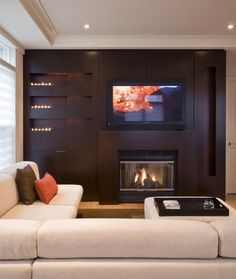 Modern living room with all wooden entertainment center with built in fireplace. This is my dream. The sectional finishes off the room perfectly.