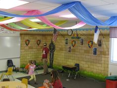 Preschool room decorations. Plastic table cloth runners, wall from oriental trading, wall decor from cheap party.