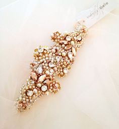 Organic crystal and pearl bridal sash. Email jamet@helenanoelle.com for details.