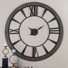 The perfect finishing touch to any room, this hansom Ronan wall clock  features a dark, rustic bronze finish accented with a rust-grey frame. Complete with powerful quartz movement, this clock showcases an open back with Roman numerals.