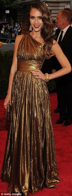 Jessica Alba at the Met ball in a one shouldered, metallic gold gown pretty