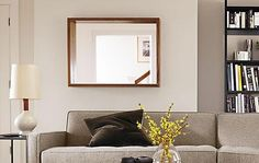 Add dimension to any room with the shadow-box frame of our Loft mirror. The clean, modern silhouette is crafted from solid wood.