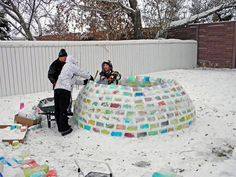 Daniel Gray and Kathleen Starrie - An igloo constructed out of milk cartons filled with colored water and frozen
