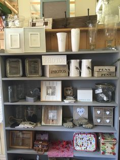 Photo frames and vases to compliment a bouquet of flowers.