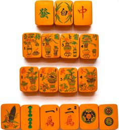 """This lovely Mahjong set is unusual in its size: the tiles are only 1"""" high, whereas others are usually 1 1/4"""". They are made of Chinese Bakelite, a substance still somewhat mysterious that really is a catch-all phrase for a number of different kinds of plastic, made in sheets and then hand-carved (in this case)."""