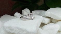 Split shank engagement ring with a cushion center by David Klass Jewelry.
