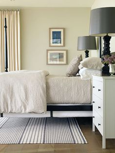 Tim Clarke - 4 poster bed, neutral colors….bedroom, beautiful bedding, wood floors, white dresser nightstands, black lamps
