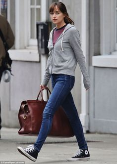 Putting her best foot forward: The movie star showed off her svelte frame in the skintight denim bottoms, opting to pair it with a striped top