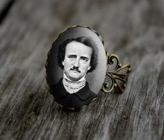 Edgar Allen Poe- vintage style ring. $15.00, via Etsy.