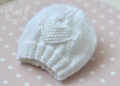 Knit this precious 4 Ply preemie and baby hat to keep little ones warm. This simple little moss stitch heart baby hat is very easy and very quick to knit. The perfect project for a new knitter. The hats in these photos have been knitted in Rowan's Extra Fine Merino Wool 4 Ply. Choose this yarn or another soft 4-ply yarn that knits to the same tension/gauge.Choose to follow detailed instructions to knit either flat on single pointed needles or in the round on DPNs, as separate instruc...