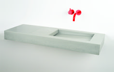 An update of a classic Kast basin. Slimline and contemporary with hidden drainage. Zingy red tap from VOLA