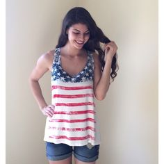 HP!! 5.29.16 American Flag Tank NWOT adorable American Flag tank!  Perfect for Memorial Day and the Fourth of July!!  Modeling size S.  Price firm unless bundled.                                                                 ▪️95% Rayon 5% Spandex.                                 ▪️Made in the USA!                                         ▪️Dry clean.                                                          PayPal Trades Boutique Tops Tank Tops
