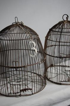 hmm :) I like dangling a number or token on a wire birdcage