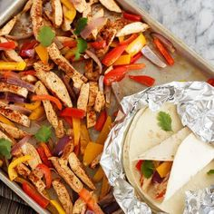 Quick and easy chicken fajitas with just one sheet pan to clean afterwards - my new favourite way to make one of my family's favourite meals! Plus a video!