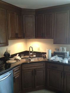 Two Poor Teachers Kitchen remodel, corner sink, stainless steel dishwasher, cabinets, under cabinet lighting