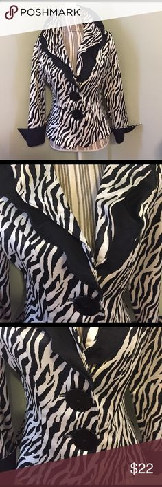 Formal Zebra Print Blazer Very very pretty! Perfect for a formal event. Material is some form of satin? (Shiny) Long sleeves with a rolled up black cuff. Jacket has shoulder pads. Two large buttons. Wire collar so you can adjust it as you like, make it lay flat or stand up etc. Size S. From a boutique- just not worn enough. Used but excellent donation! Name brand Design Today's. 100% polyester. Dry clean only. Like this? Feel free to make a reasonable offer! Use the offer button! Thanks for…