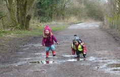 Autumn and Josh exploring the mud.