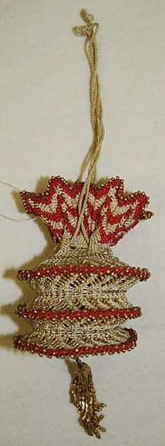 This is an reticule made in 1810-25. A reticule is a small handbag that has drawstrings at the top.