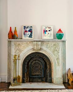 Gorgeous fireplace (and paintings by Kim Gordon).