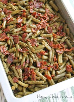 Arkansas Green Beans 5 cans green beans, drained 12 slices bacon cup brown sugar cup butter, melted 7 teaspoons soy sauce 1 teaspoons garlic powder Preheat oven to 350 degrees. Place the drained green beans in a baking pan. Side Dish Recipes, Vegetable Recipes, Great Recipes, Favorite Recipes, Yummy Recipes, Snack Recipes, Healthy Recipes, I Love Food, Good Food