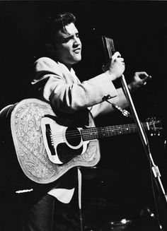 Elvis photographed by Bill Ray during a concert at the Minneapolis Auditorium, Minnesota, May 13, 1956.