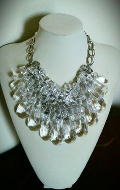 """Icicles in Winter"" Lucite/Acrylic Graduated Bib Necklace...crystal clear teardrop faceted shapes in graduated sizes, finished with large double twisted cable chain & adjustable lobster clasp/chain closure."