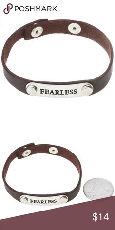 "<< Fearless Leather Stamped Metal Bracelet >> Lather bracelet with a silver metal pendant with stamped word ""fearless"". Snap closure with two adjustable lengths. Jewelry Bracelets"