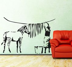 A brilliant wall sticker from Banksy of a Zebra losing its stripes. One of the best known works of this revolutionary urban graffiti artist. A great art piece for the walls of your home. #Graffiti #WallArt #Creative