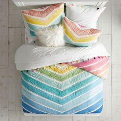 Vibrant colors meet statement patterns in our Rainbow Chevron Quilt. Made from pure cotton and featuring hand-embroidered stitching, this vivid design will add a stylish touch to your room. Rainbow Bedding, Rainbow Bedroom, Rainbow Room Kids, Rainbow House, Rainbow Nursery, Chevron Bedding, Chevron Quilt, Bright Bedding, Bedroom Ideas