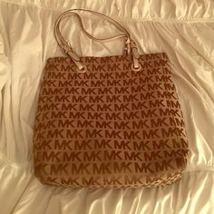 Michael Kors Tote Mk tote. Khaki and brown. No tassel. A few small stains, nothing drastic & can barely notice thats why only asking $75 Even though its still a great purse! Michael Kors Bags Totes