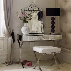 Glass Console Table | Mirrored console tables are an amazing choice to brighter spaces. Add this glass console table to white and simple spaces and make dramatic sets | Discover more console tables with drawers: http://modernconsoletables.net
