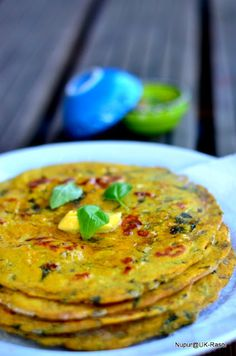 Besan Masala Roti - 2 cup Besan ( Gram Flour) ½ cup Atta ( Whole Wheat flour) 1 tsp red chilli powder, black pepper, coriander powder each Salt to taste 1 tbsp Oil ½ tsp Turmeric, dry Mango powder each 1 tsp Green chili Paste 1 tsp grated Ginger Warm water to knead Few sprigs of fresh coruiander leaves, chopped