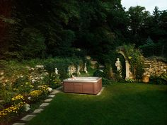 We have the stone path, the shrubs and flowers as well as a couple of these statues! I see it coming together!