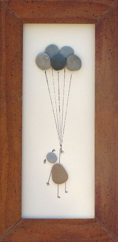 """Up, up and away"" 12"" x 4"" Created using pebbled I collected on the shores of Lake Michigan."