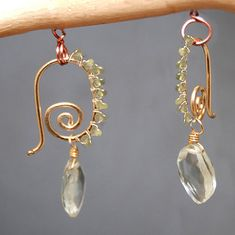 Hammered small spiral earrings peridot green by CalicoJunoJewelry  Love the detail. Gorgeous