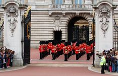 See the changing of the guard at Buckingham Palace