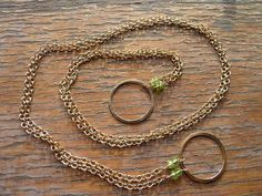 Long gold circle necklace with peridot