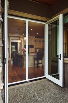 Our retractable screen doors by Phantom are the only retractable door screen with an integrated latch & release handle making it easy to use, quiet to operate and secure from unintended openings. Double Screen Doors, Sliding Patio Screen Door, Double Sliding Glass Doors, Glass Screen Door, Front Door With Screen, French Doors With Screens, Retractable Screen Door, Double Doors Exterior, Exterior Doors With Glass