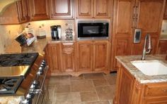 Light stained kitchen cabinetry with paneled refrigerator and wall microwave Stained Kitchen Cabinets, Kitchen Cabinetry, Cabinets And Countertops, Healthy Snacks For Adults, Healthy Buffalo Chicken, Bbc Good Food Recipes, Healthy Diet Plans, Fruit And Veg, Custom Cabinetry