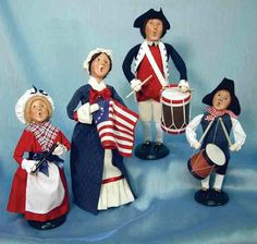 Byers' Choice Patriotic Family    The entire family celebrates their freedom. These highly appreciable figurines are crafted by hand from snippets of fabric and whatnot. The distinctive singing mouths on winsome faces have delighted collectors for decades.  http://www.victoriantradingco.com/store/catalogimages/1a/i13531.html