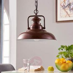 Pendant light Nico is delivered with a rustic-looking chain suspension, and the lampshade made from painted metal can hardly deny its rustic character either. It has an antique brown colour which goes very well with a country house interior.