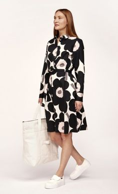 The Trina dress is a classic button-up dress, which is made of cotton poplin in the black, beige and off white Unikko 640 pattern. The dress has a metal button closure, a detachable belt, side seam pockets and an A-line hem that ends at the knee. Marimekko Dress, Off White Color, Online Dress Shopping, Dresses For Work, Street Style, How To Wear, Outfits, Clothes, Pattern Designs