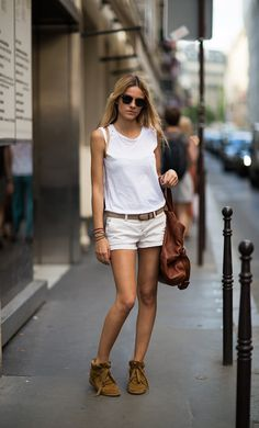 Tagged with Isabel Marant. Isabel Marant sneakers are worn by Miranda Kerr and Rosie Huntington-Whiteley. Isabel Marant's womenswear collection is bohemian cool inspired. The Etoile Isabel Marant line is sold at Net-a-Porter.
