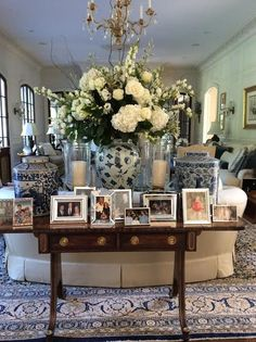 Flowers & Chinoiserie.  console with arranged photos - great idea.  love it.