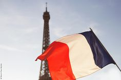 Eiffel tower and French Flag / Paris, France / Photo by Carin Olsson