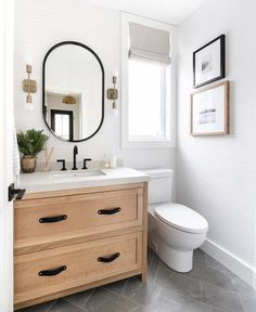 Since we first shared our powder room renovation in September we've added a few finishing details like the art and Roman shade! Bathroom Inspo, Bathroom Inspiration, Bathroom Ideas, Decorating A Bathroom, Parisian Bathroom, Neutral Bathroom, Diy Bathroom Remodel, Simple Bathroom, Bathroom Organization