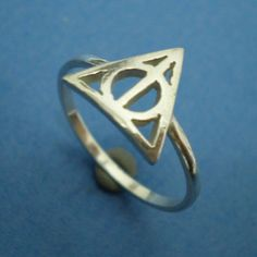 Deathly Hallows Triangle Harry Potter Ring. $29.00, via Etsy. - make this in gold someone!